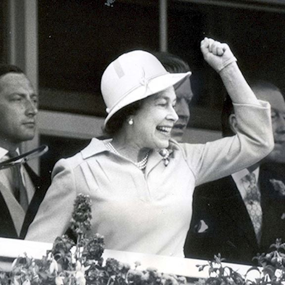 Black and white image of The Queen cheering in 1978