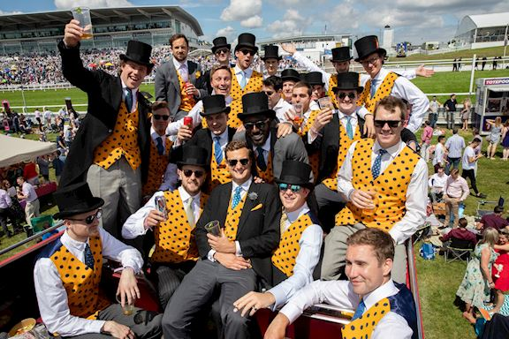 Group of men in matching outfits on Derby Day